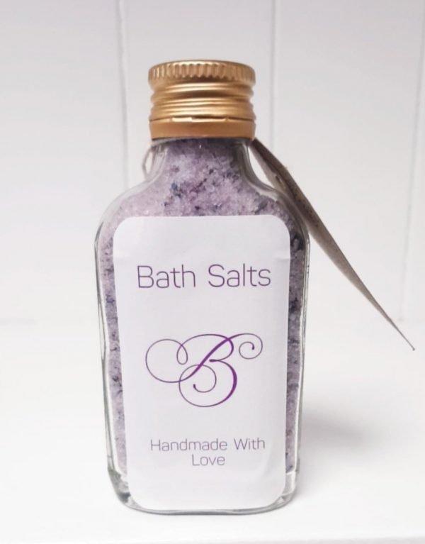 Bottle of lilac coloured bath salts for sleep