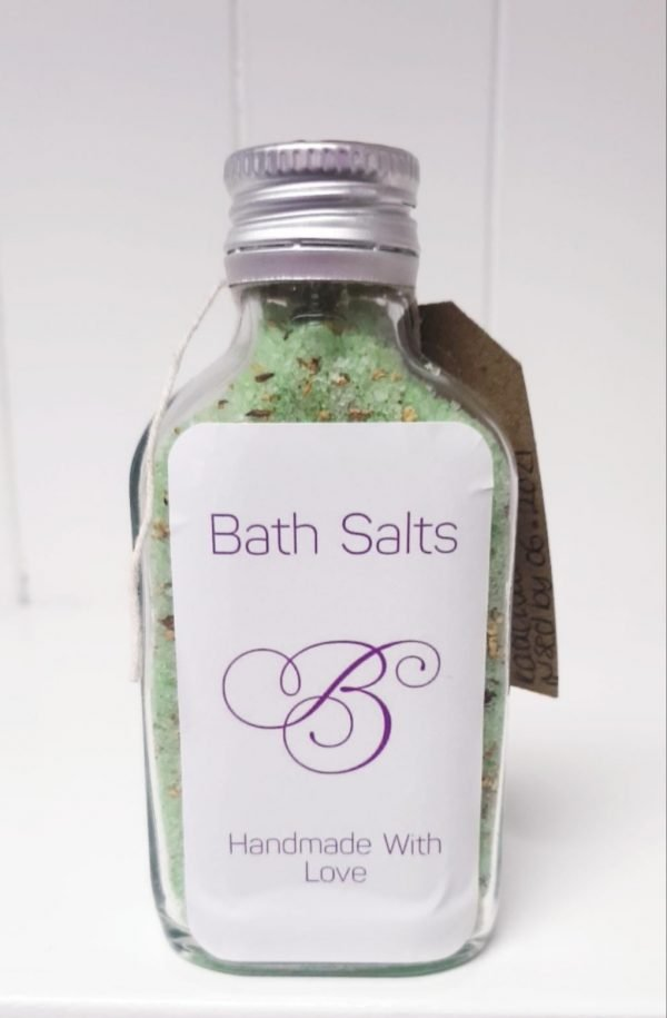 Bottle of green bath salts for sore muscles.