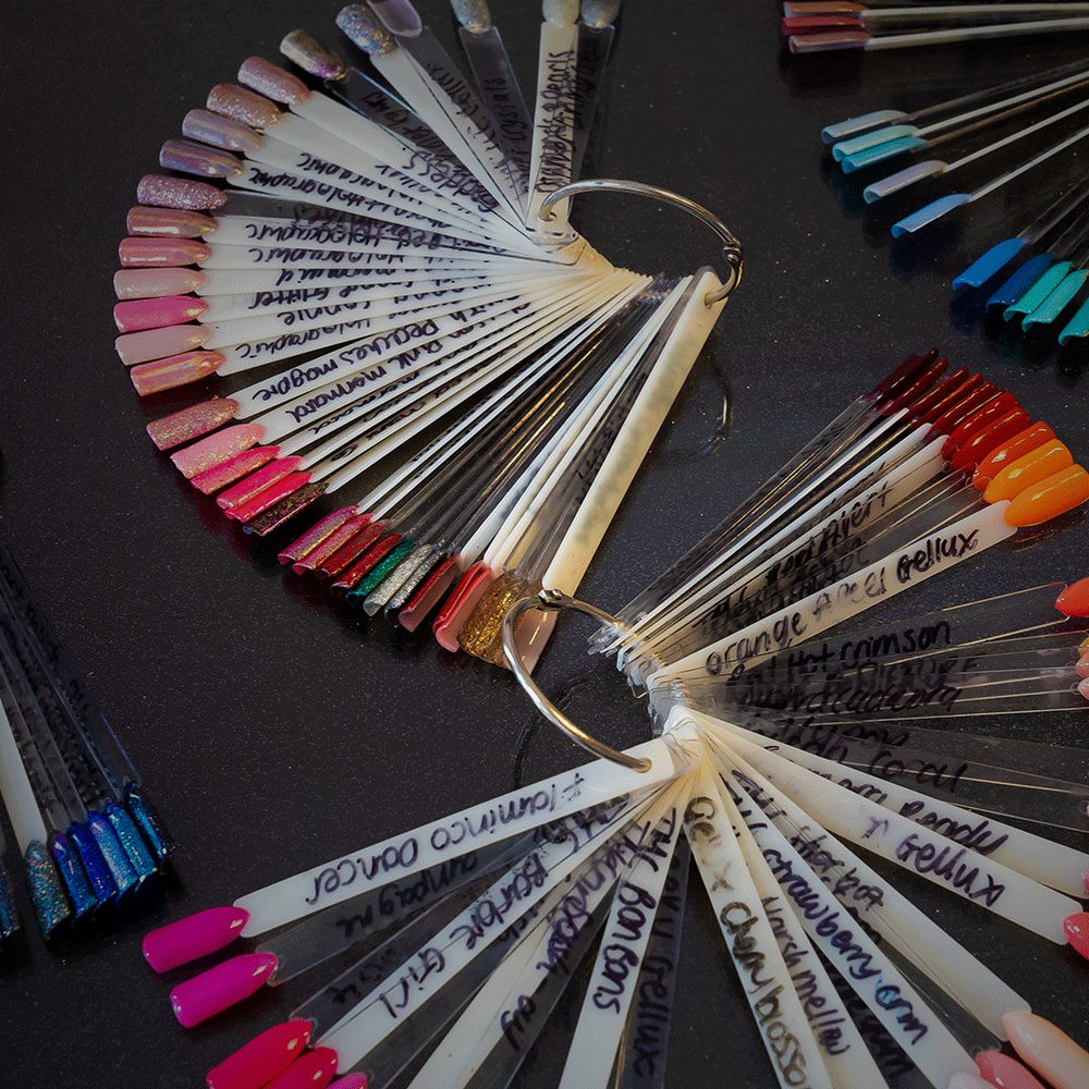 a fan of samples of different gel nail colours