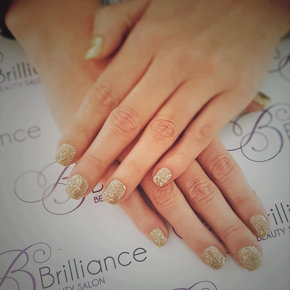 manicure with gold glitter gel nails