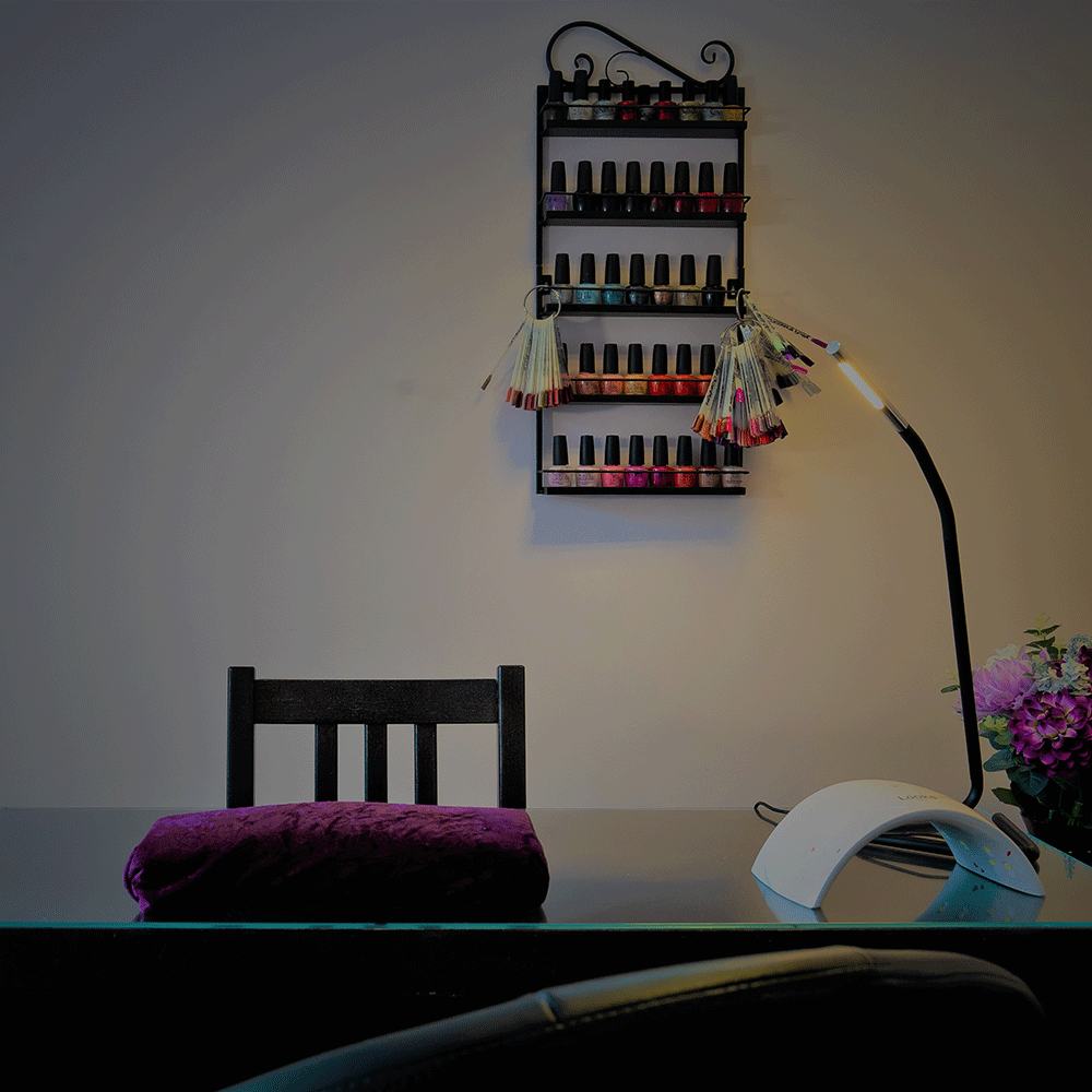 Brilliance beauty salon pedicure desk with shelf in background containing all the different gel nail colours