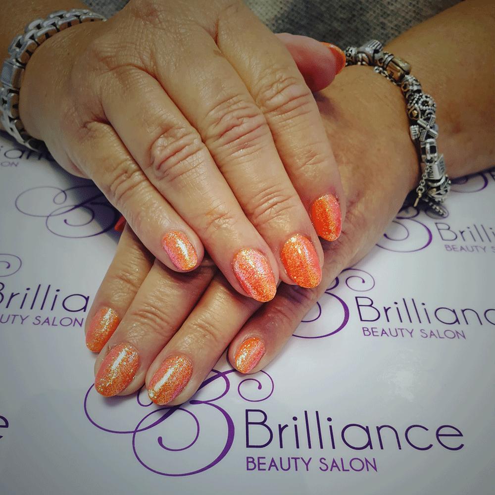 manicure with orange glitter gel nails