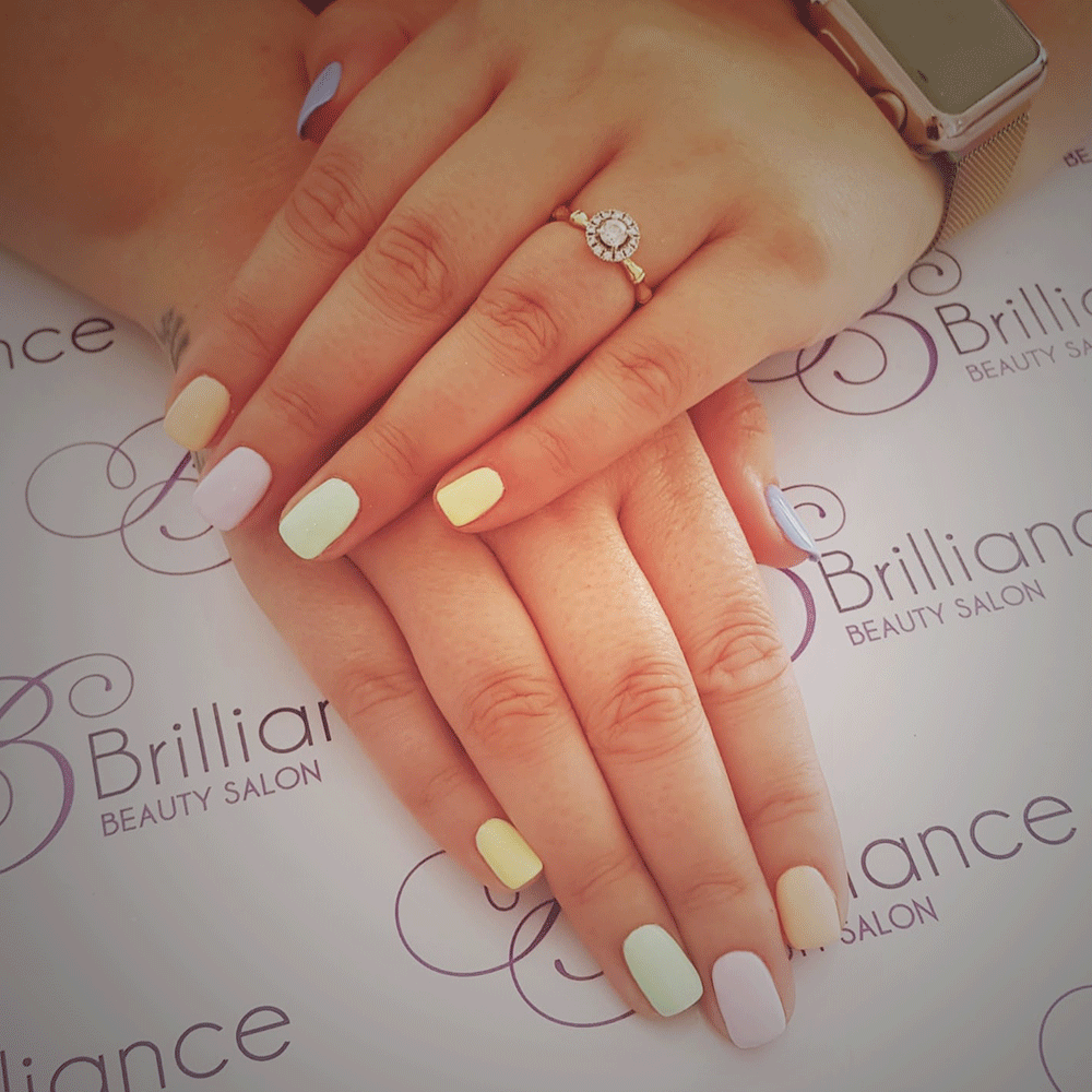 manicure/hands with multicoloured pastel gel nails