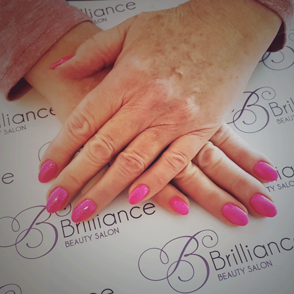 manicure/hands with fuscia pink gel nails