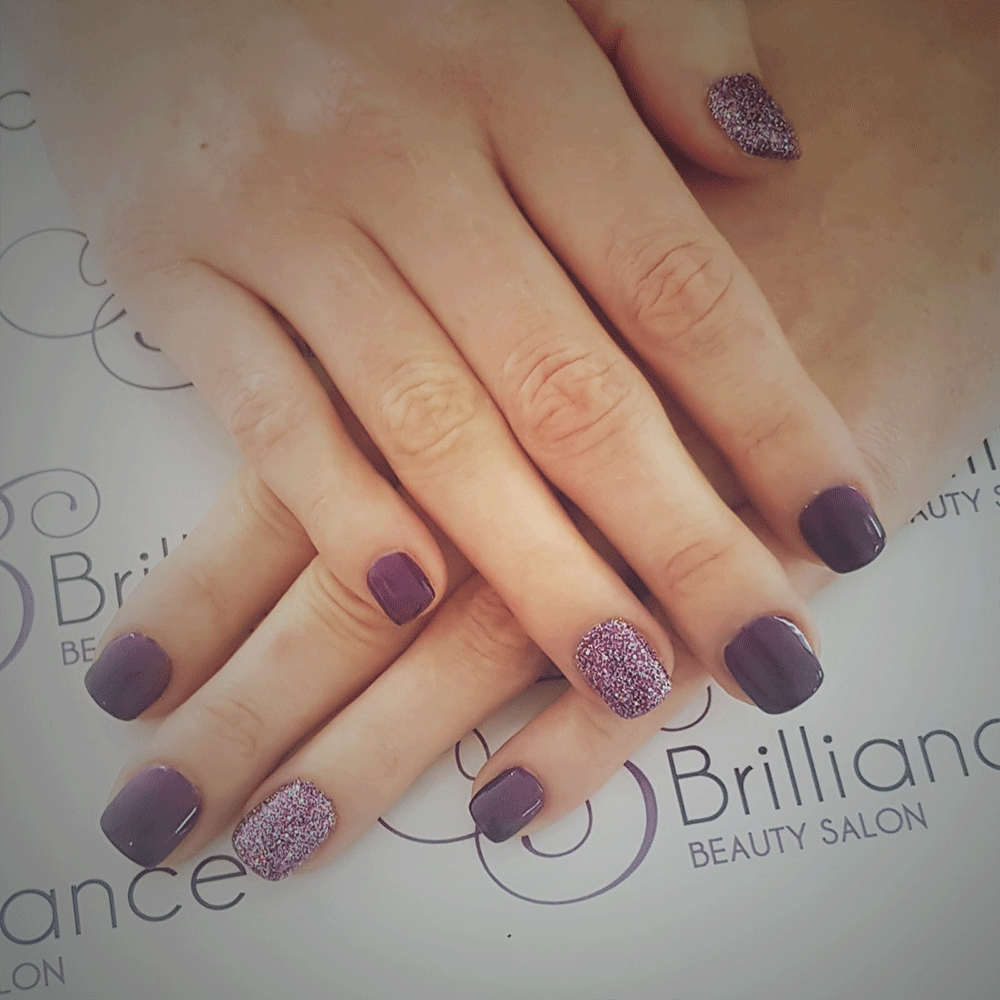 manicure/hands with plain purple and purple glitter gel nails