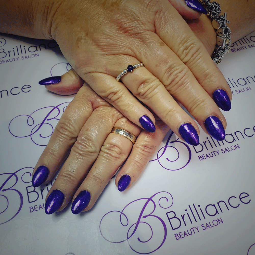 manicure/hands with bright purple gel nails