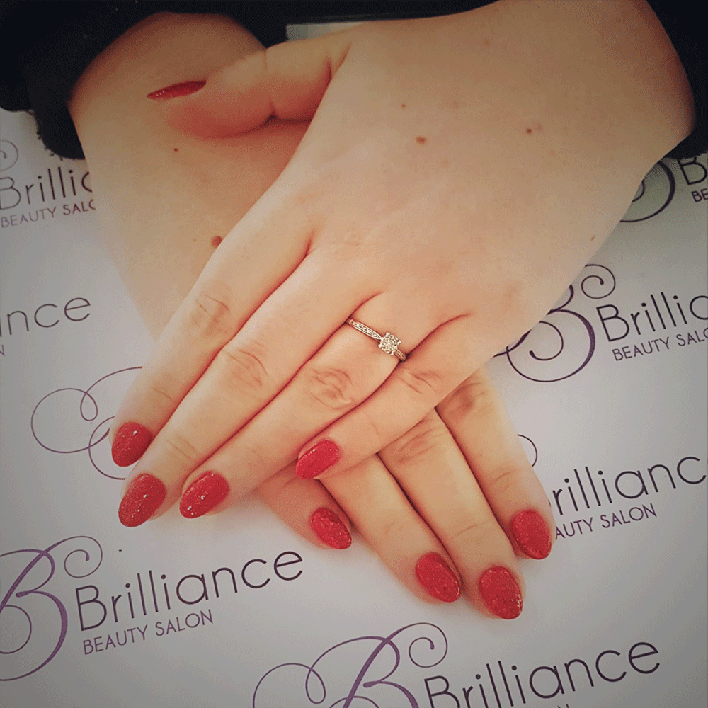 manicure/hands with bright red gel nails