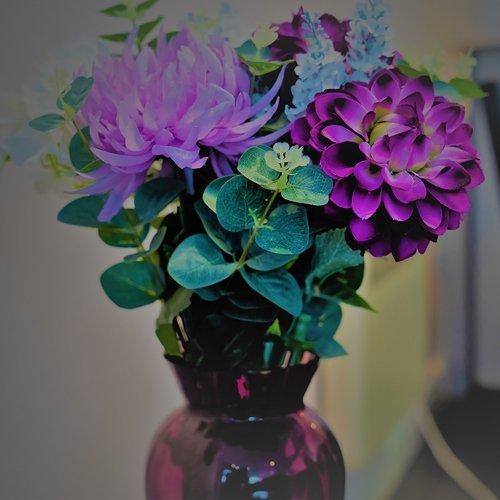 Purple flowers in a purple vase on display in the beauty salon