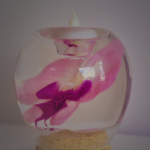 Orchid glass vase with candle